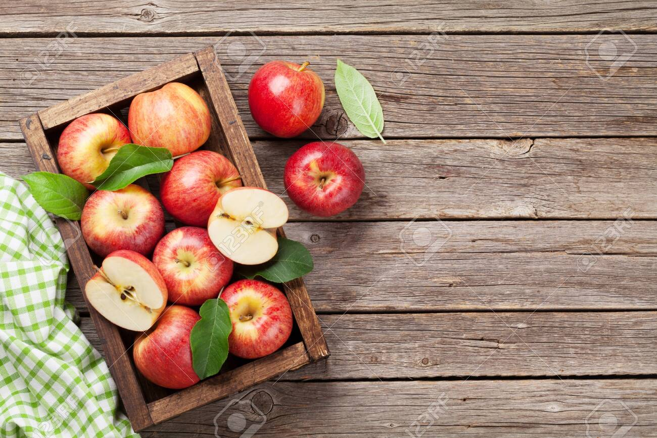 Ripe red apples on wooden table. Top view with space for your text - 120720133