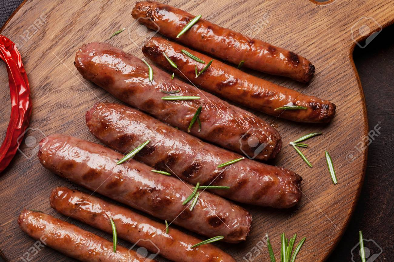 Grilled sausages with rosemary herbs. Top view - 121068255