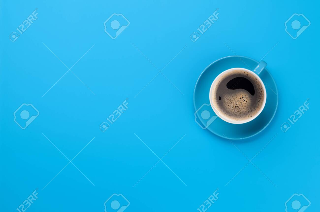 Blue coffee cup over blue background. Top view flat lay with copy space - 124556070