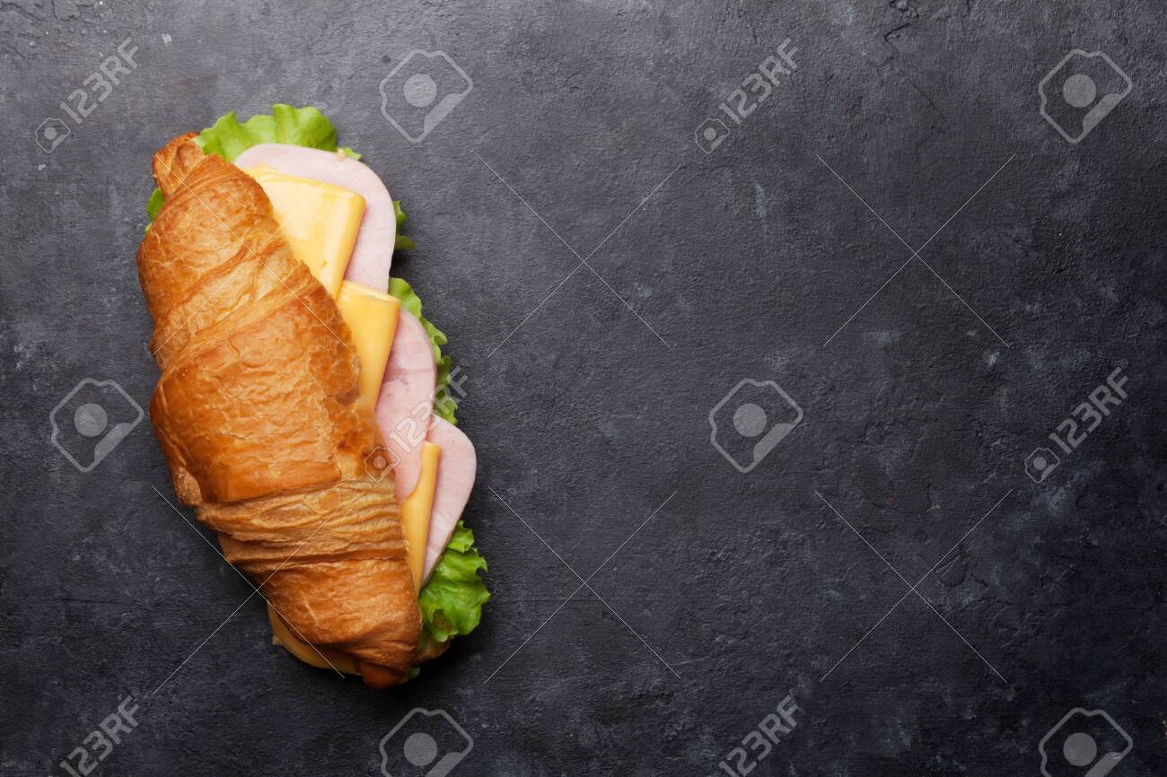 Croissant sandwich on stone table. French breakfast. Top view flat lay with copy space for your text - 125156692