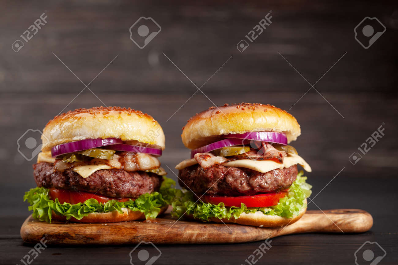 Homemade tasty burgers with big beef, cheese, tomato, bacon and lettuce. With copy space - 155276255
