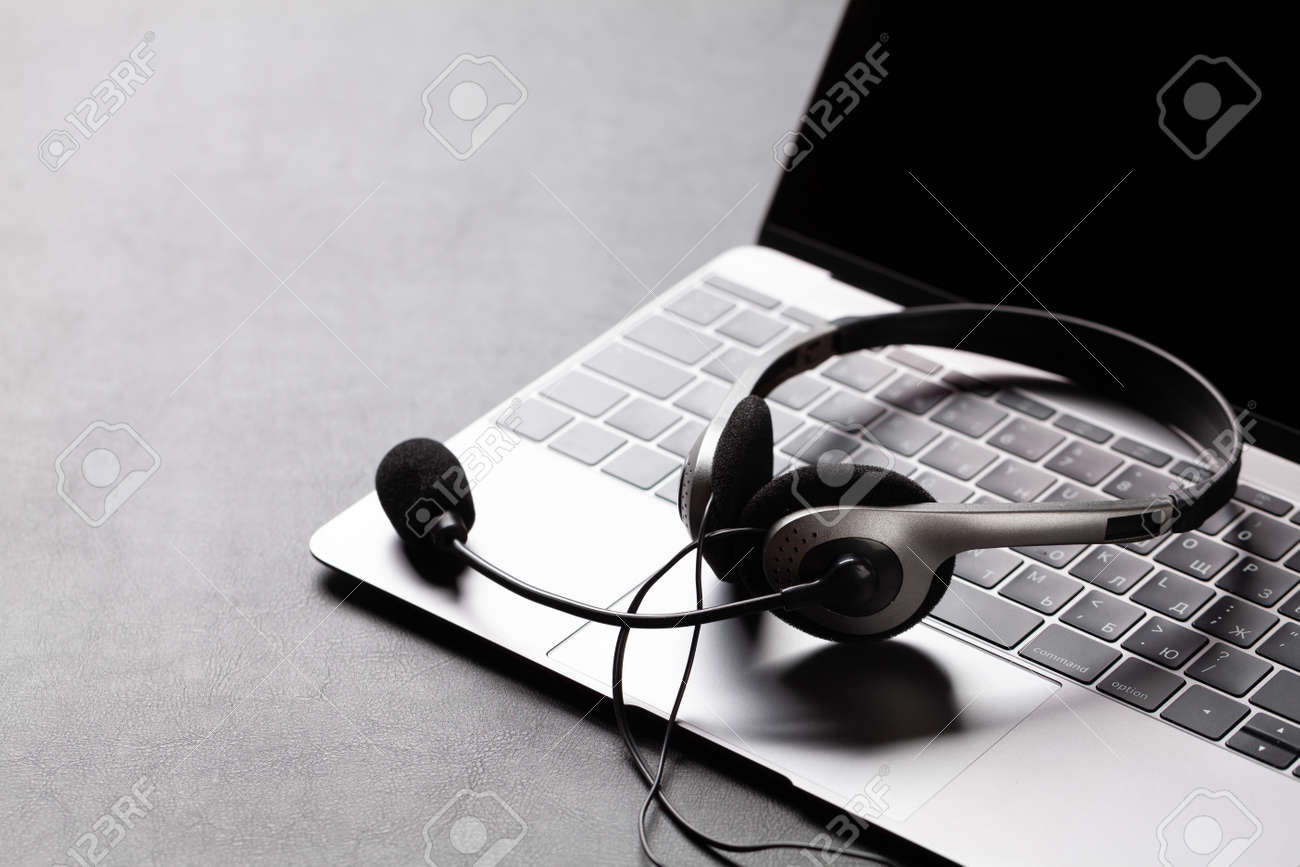 Office desk with headset and laptop. Remote office and work from home concept. With copy space - 158506997