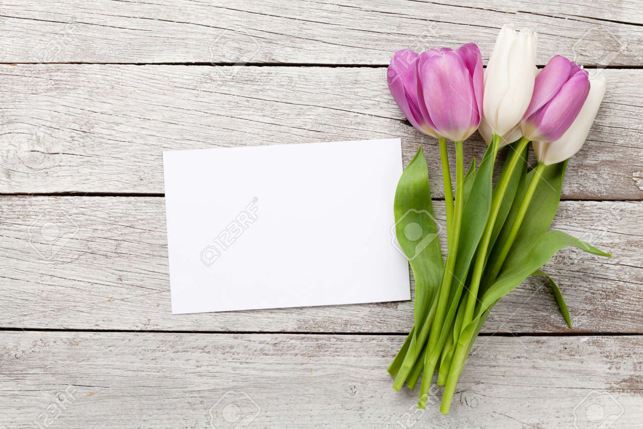 Tulip flowers bouquet. Easter greeting card template. With space for your greetings. Top view flat lay - 166731395