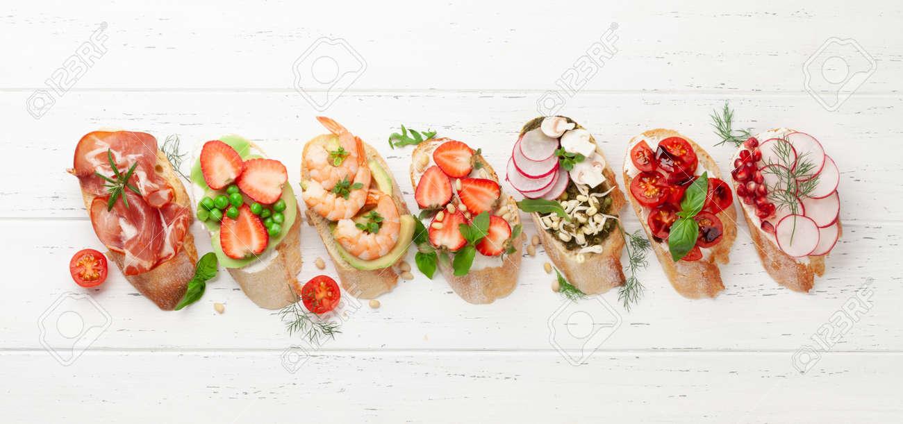 Appetizers plate with traditional spanish tapas set. Italian antipasti brushetta snacks. Top view flat lay - 169549657