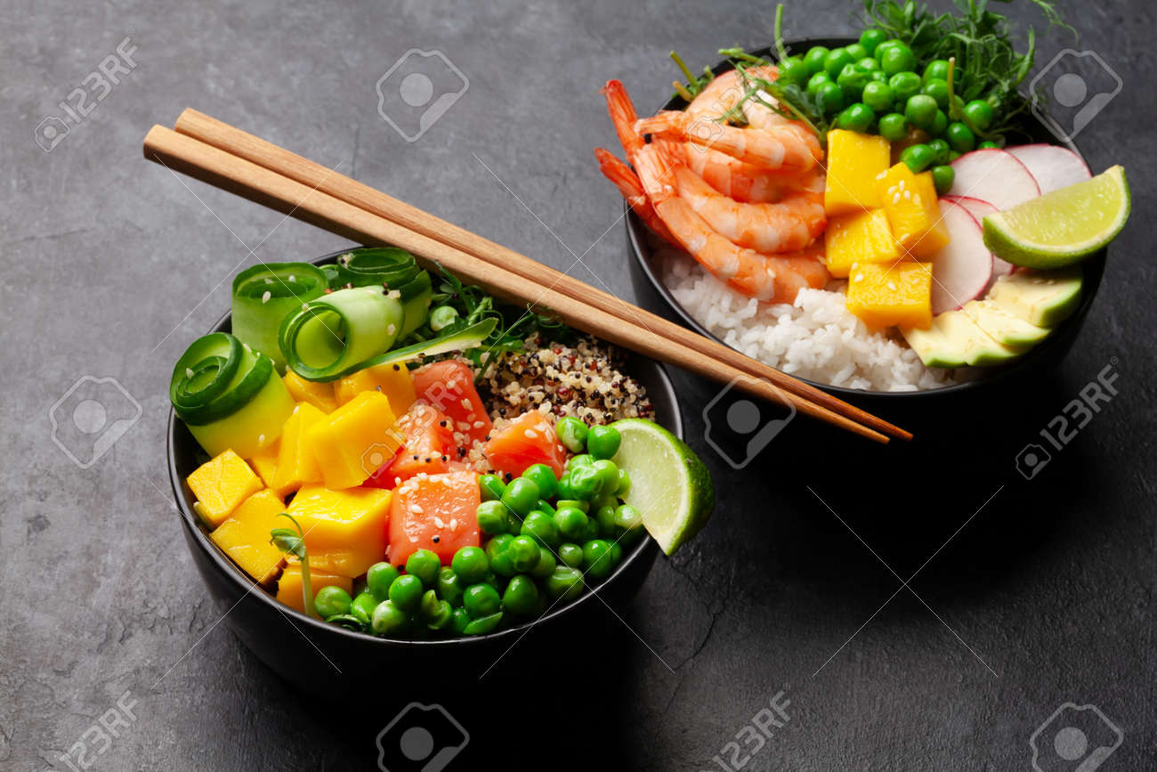Poke bowls with shrimps, salmon, avocado and mango. Traditional hawaiian meal - 169549687