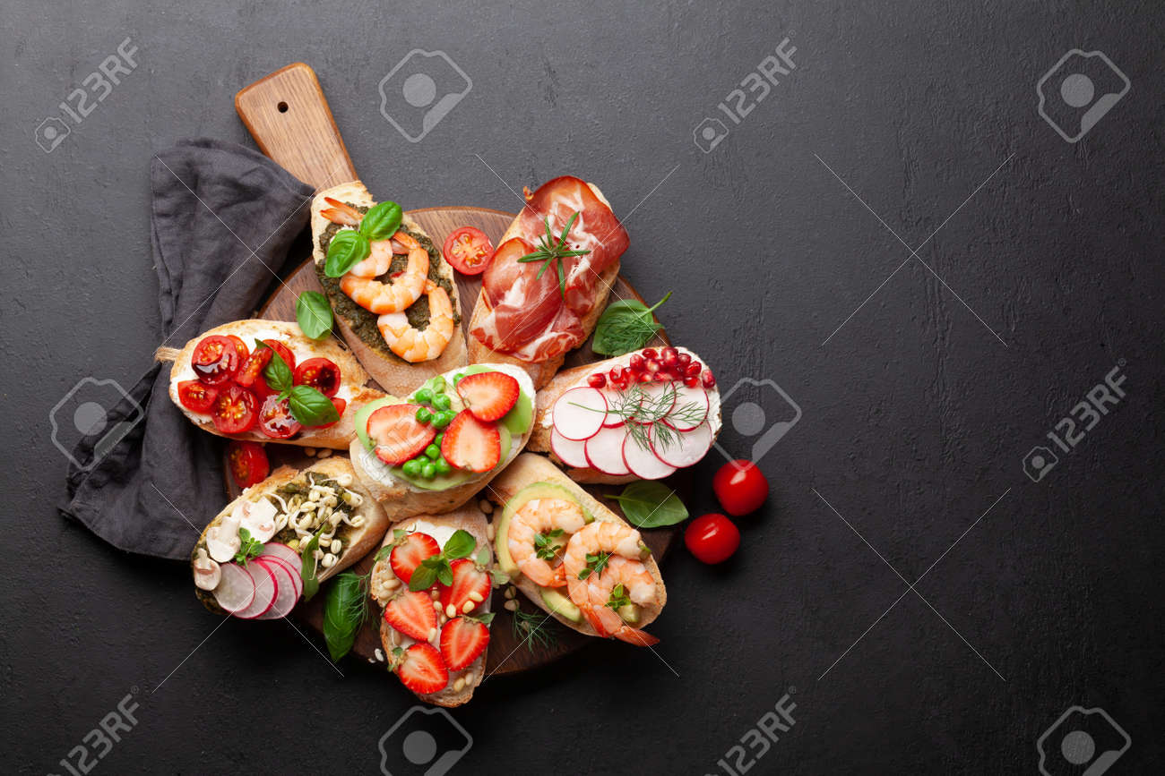 Appetizers plate with traditional spanish tapas set. Italian antipasti brushetta snacks. Top view flat lay with copy space - 169549718