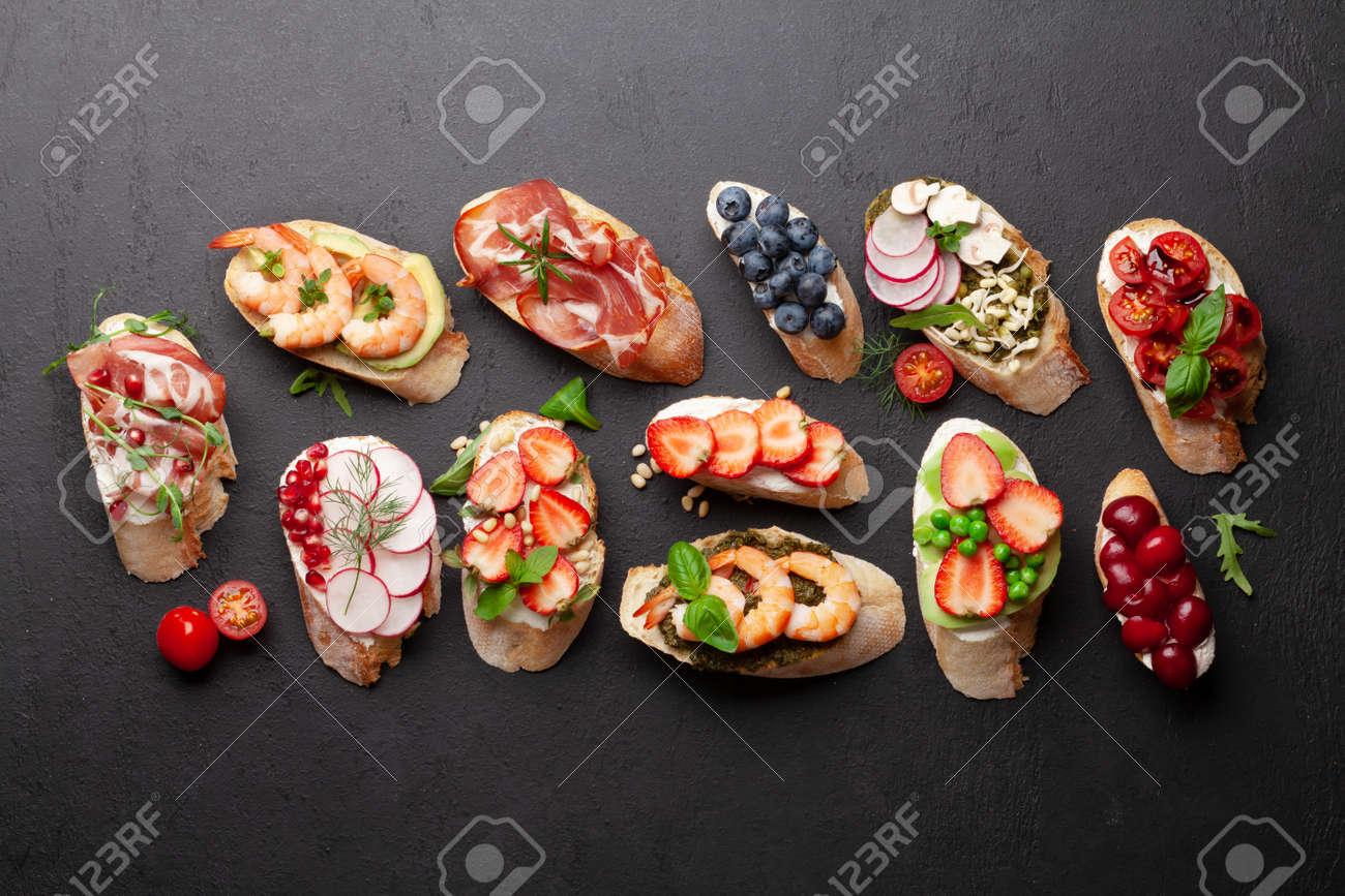 Appetizers plate with traditional spanish tapas set. Italian antipasti brushetta snacks. Top view flat lay - 169549749