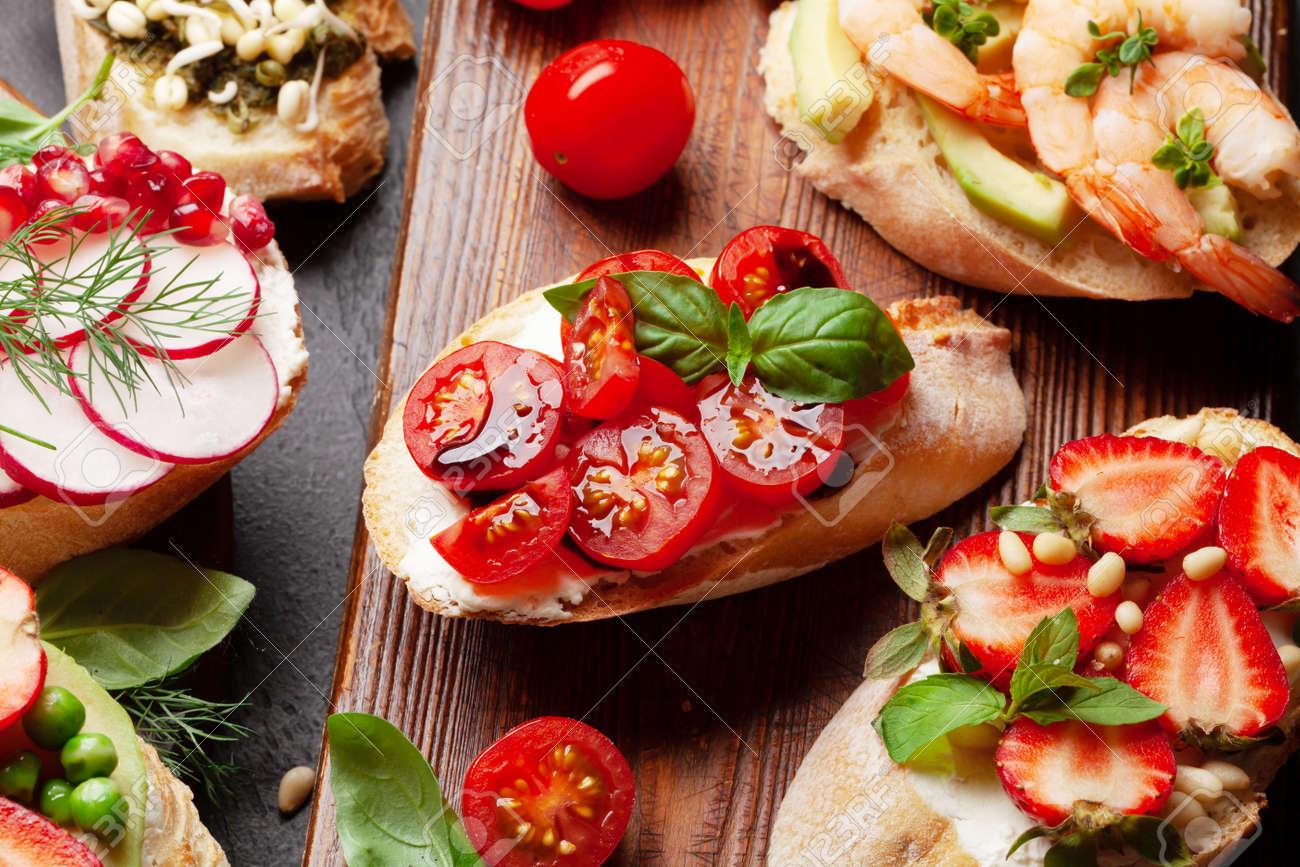 Appetizers board with traditional spanish tapas set. Italian antipasti bruschetta snacks - 169549778