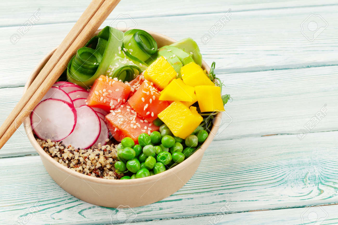 Poke bowl with salmon, cucumber and mango. Traditional hawaiian meal. With copy space - 169549810