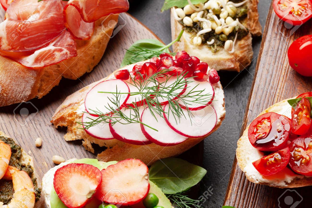 Appetizers board with traditional spanish tapas set. Italian antipasti bruschetta snacks - 169549882