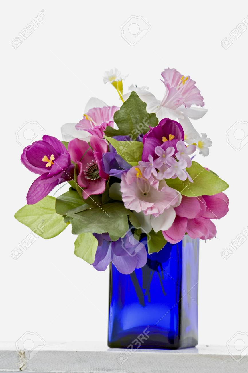 Decorative Traditional Blue Bottle With Fake Flowers Stock Photo