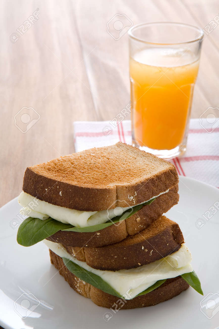 Egg White Sandwich On Wheat Toast, Green Spinach, And Fresh ...