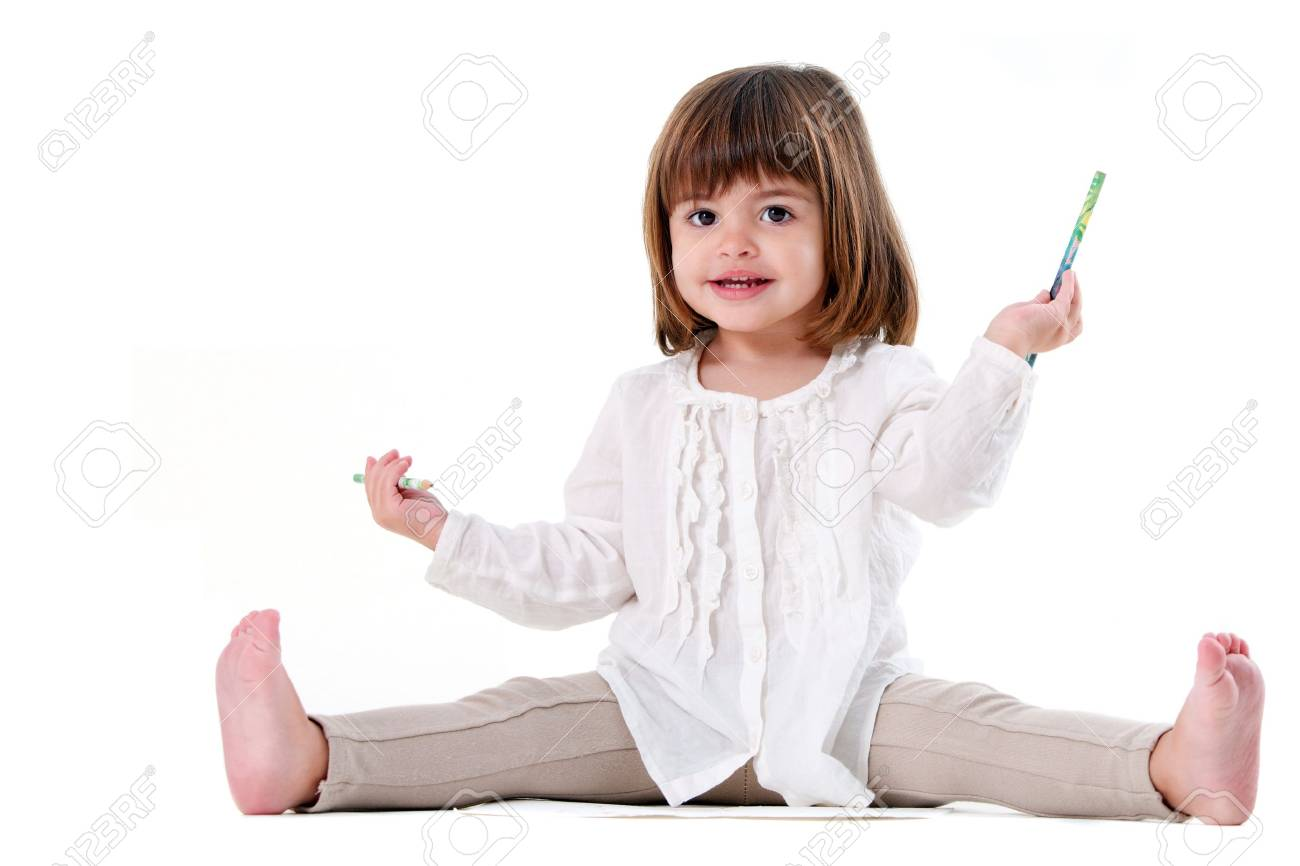 Portrait of cute little girl holding pencils. Isolated on white background. Stock Photo - 12285401
