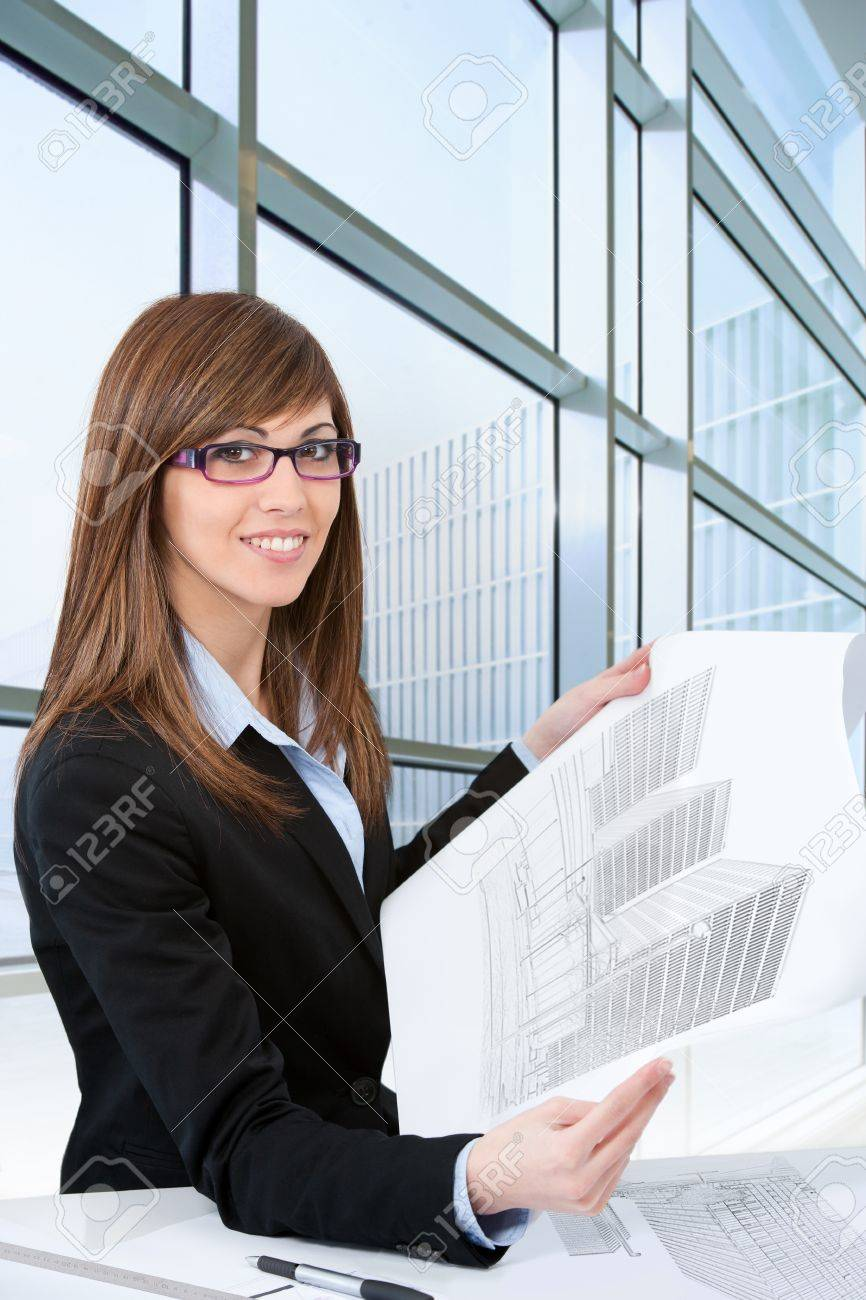 Portrait of Attractive young female architect with plans in office Stock Photo - 15446614