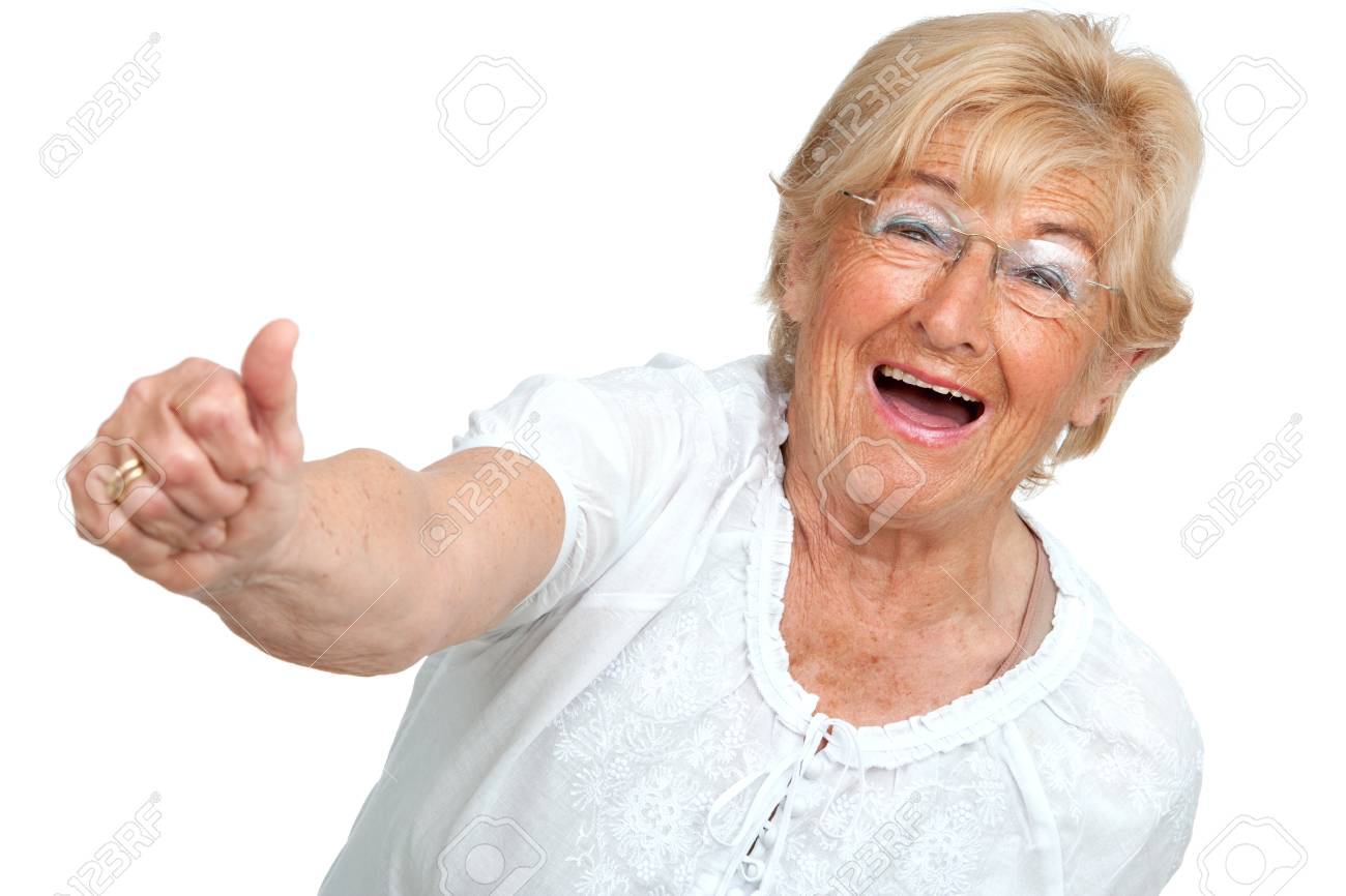 Happy senior woman showing thumbs up Isolated on white Stock Photo - 13294571