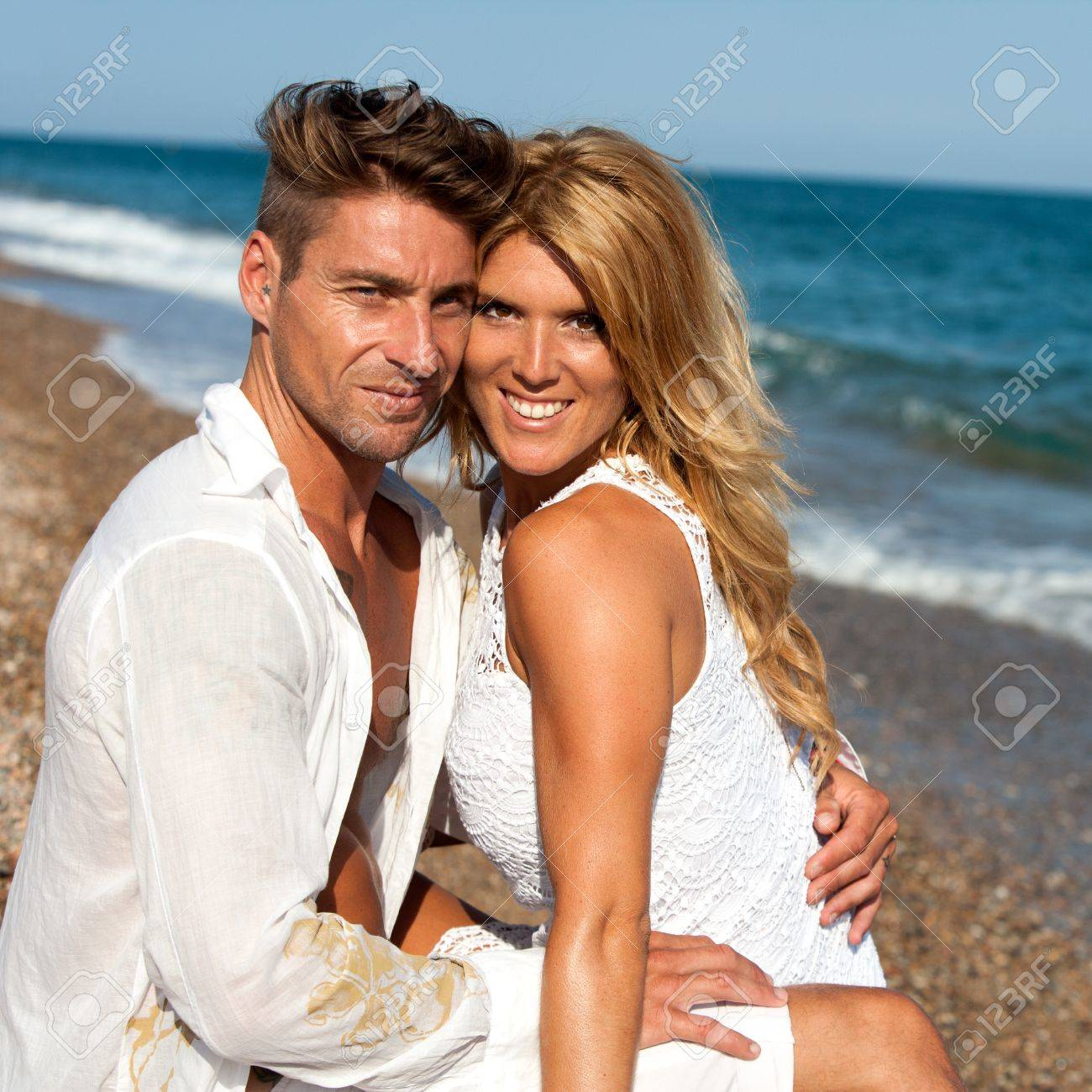 Close up portrait of handsome couple with heads together on beach Stock Photo - 15388561