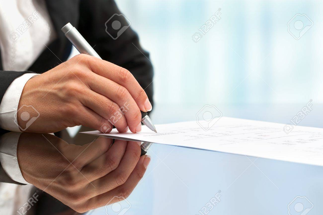 Extreme close up of female business hand signing document. Stock Photo - 15686184