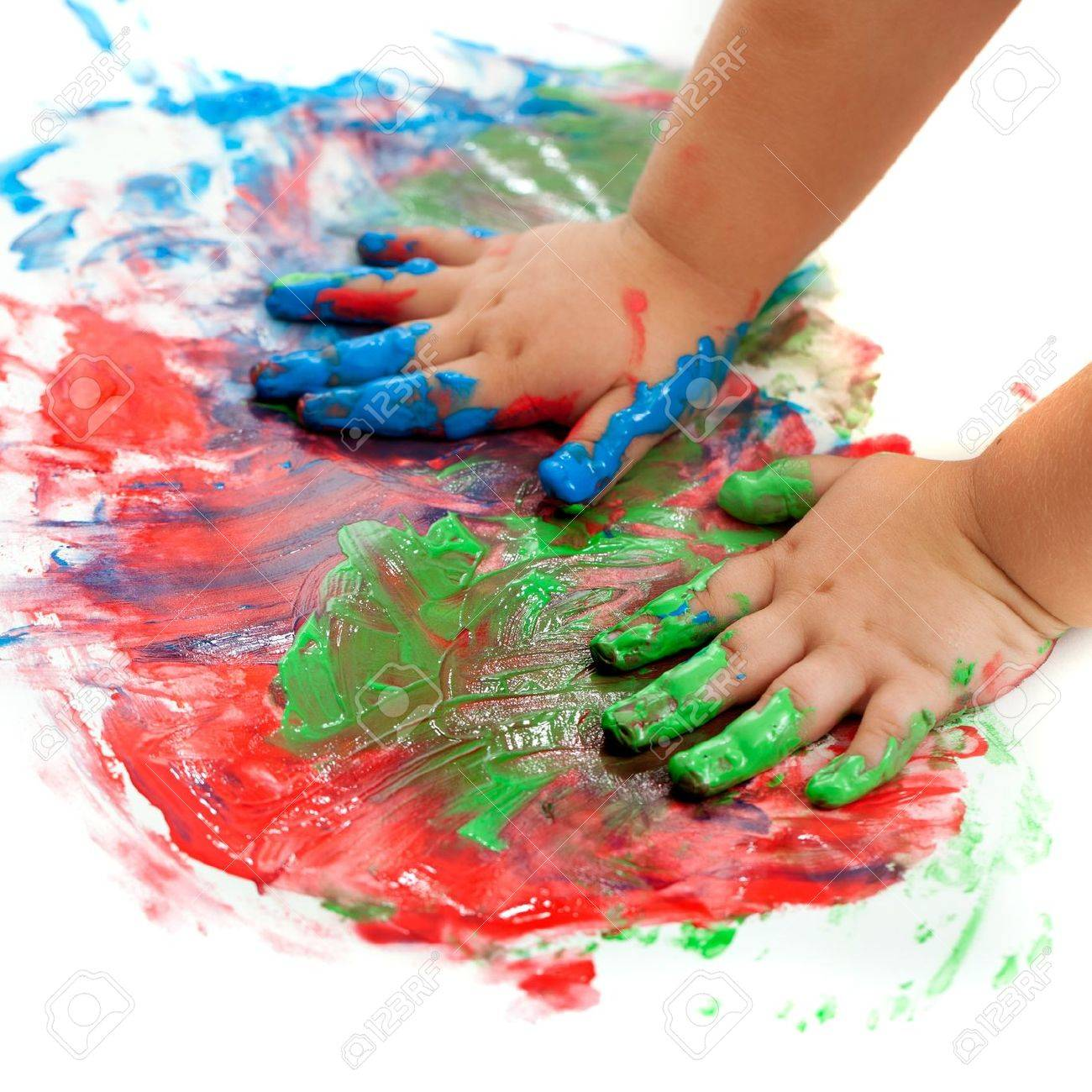 Close up of baby hands painting mosaic. Stock Photo - 15824015