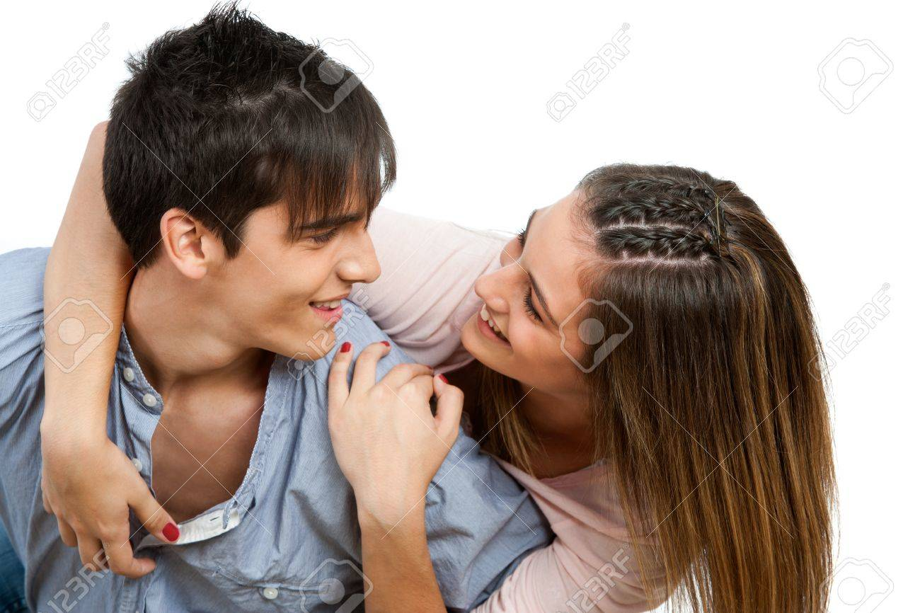 Close up portrait of teen couple with in love face expression.Isolated. Stock Photo - 16300812
