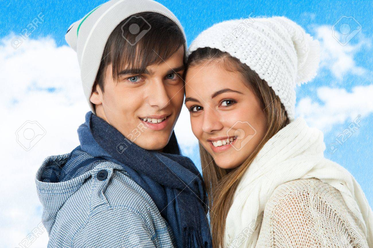 Close up portrait of cute teen couple in winter clothes. Stock Photo - 16300846