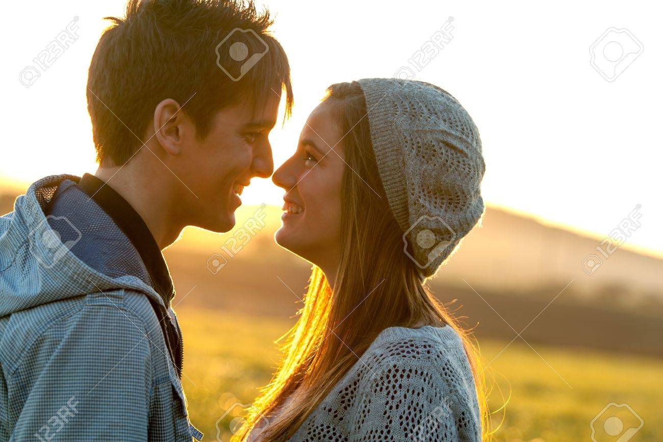 Close up portrait of romantic couple scene at sunset. Stock Photo - 16971377
