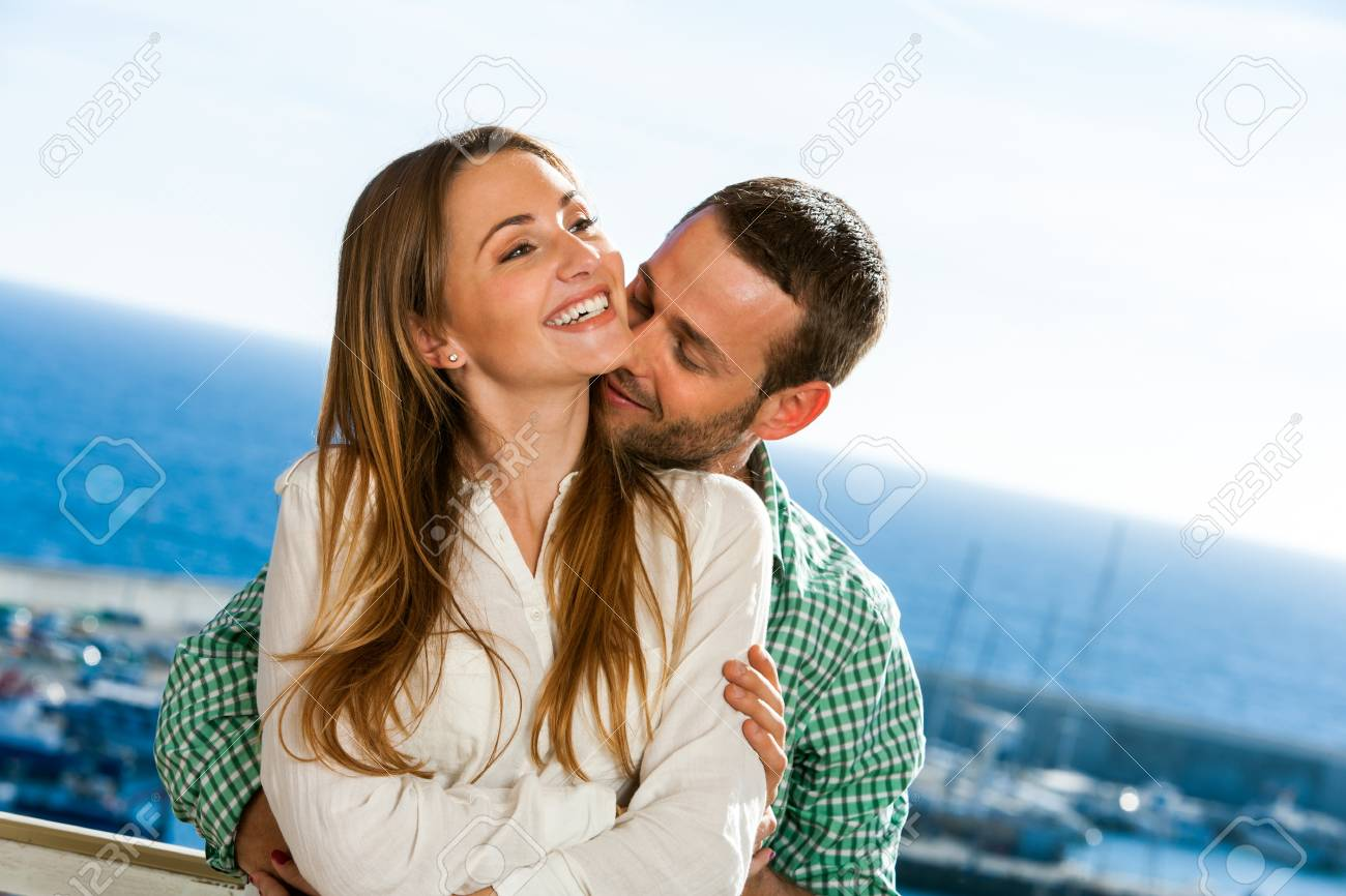Close up portrait of young couple sharing secrets outdoors. Stock Photo - 17239232