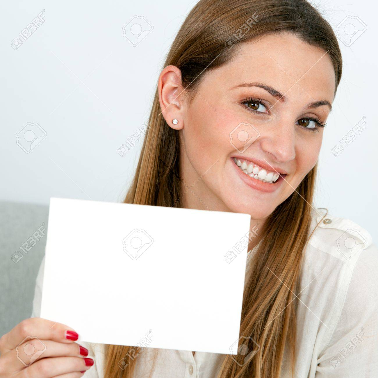 Close up portrait of attractive young woman holding white card. Stock Photo - 17239271