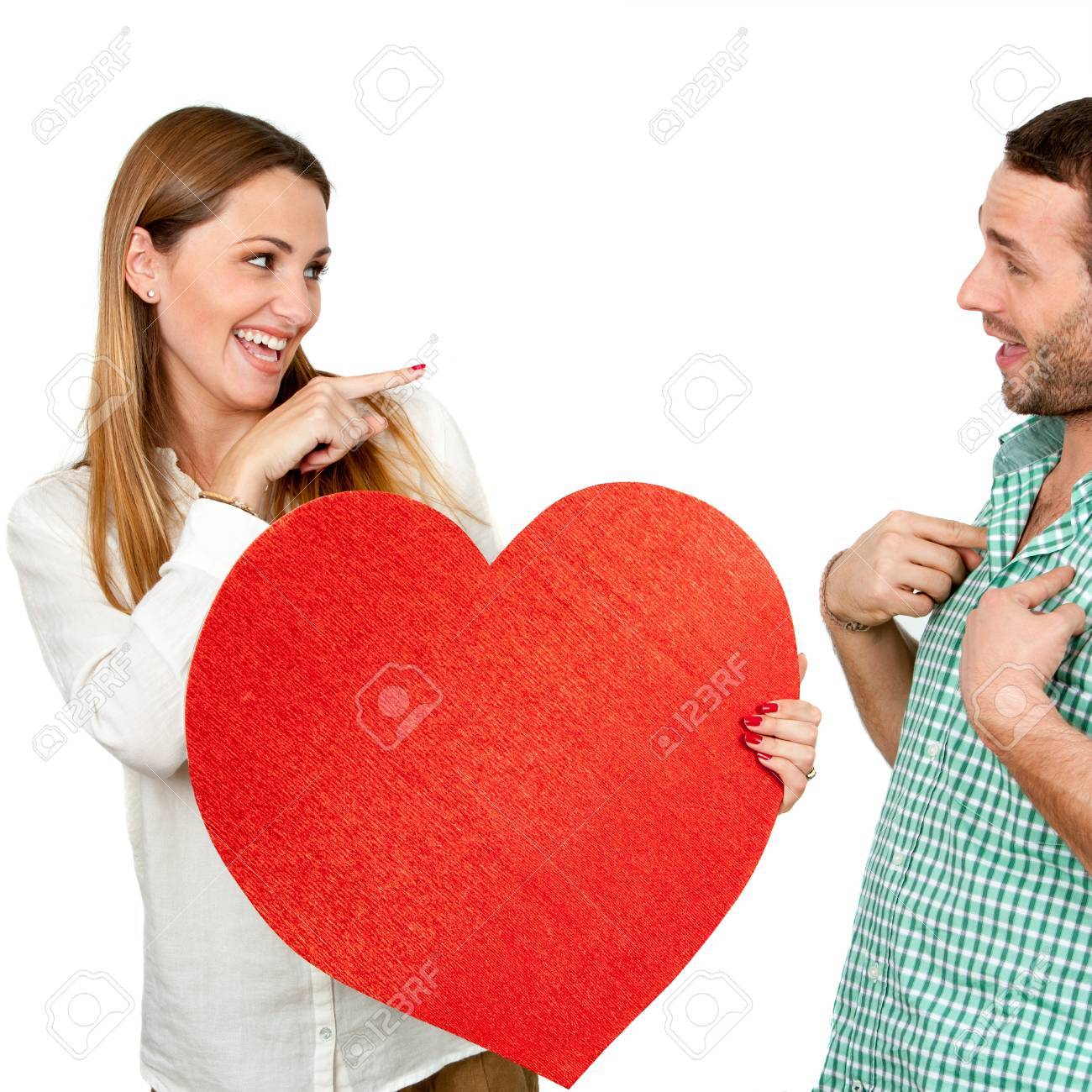 Cute Girl Holding Heart Symbol Pointing At Boy.Isolated On White ...