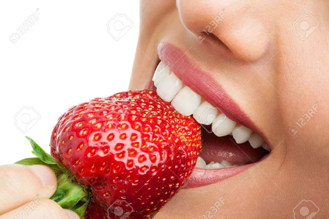 Macro close up of woman's mouth eating strawberry. Stock Photo - 19362886