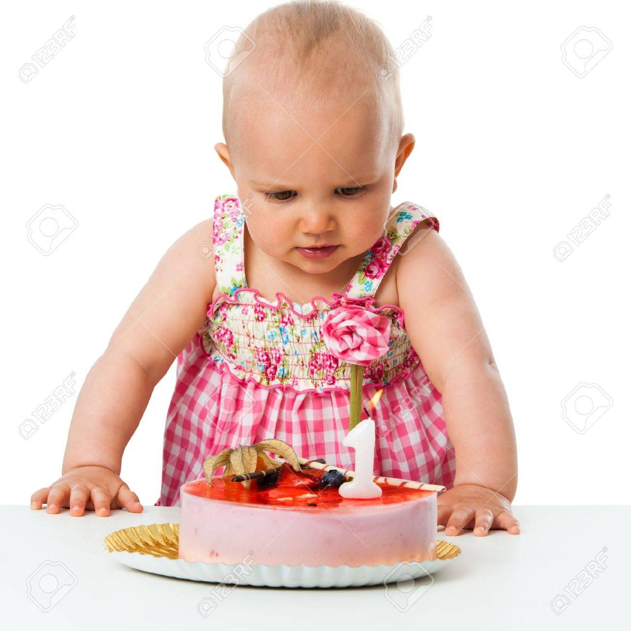 Portrait Of Cute Baby Girl Celebrating First Birthday With Cake