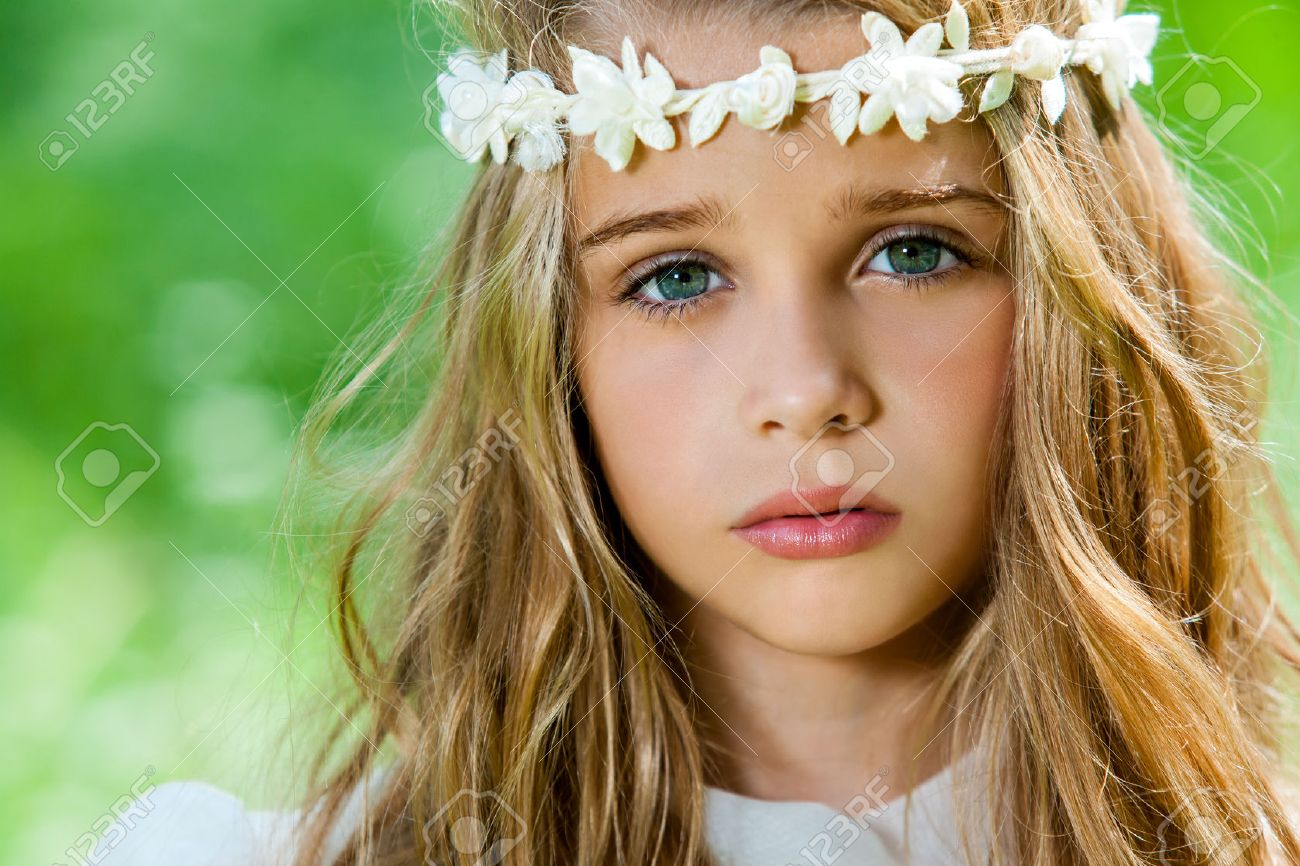extreme close up of cute girl with flower headband outdoors. stock