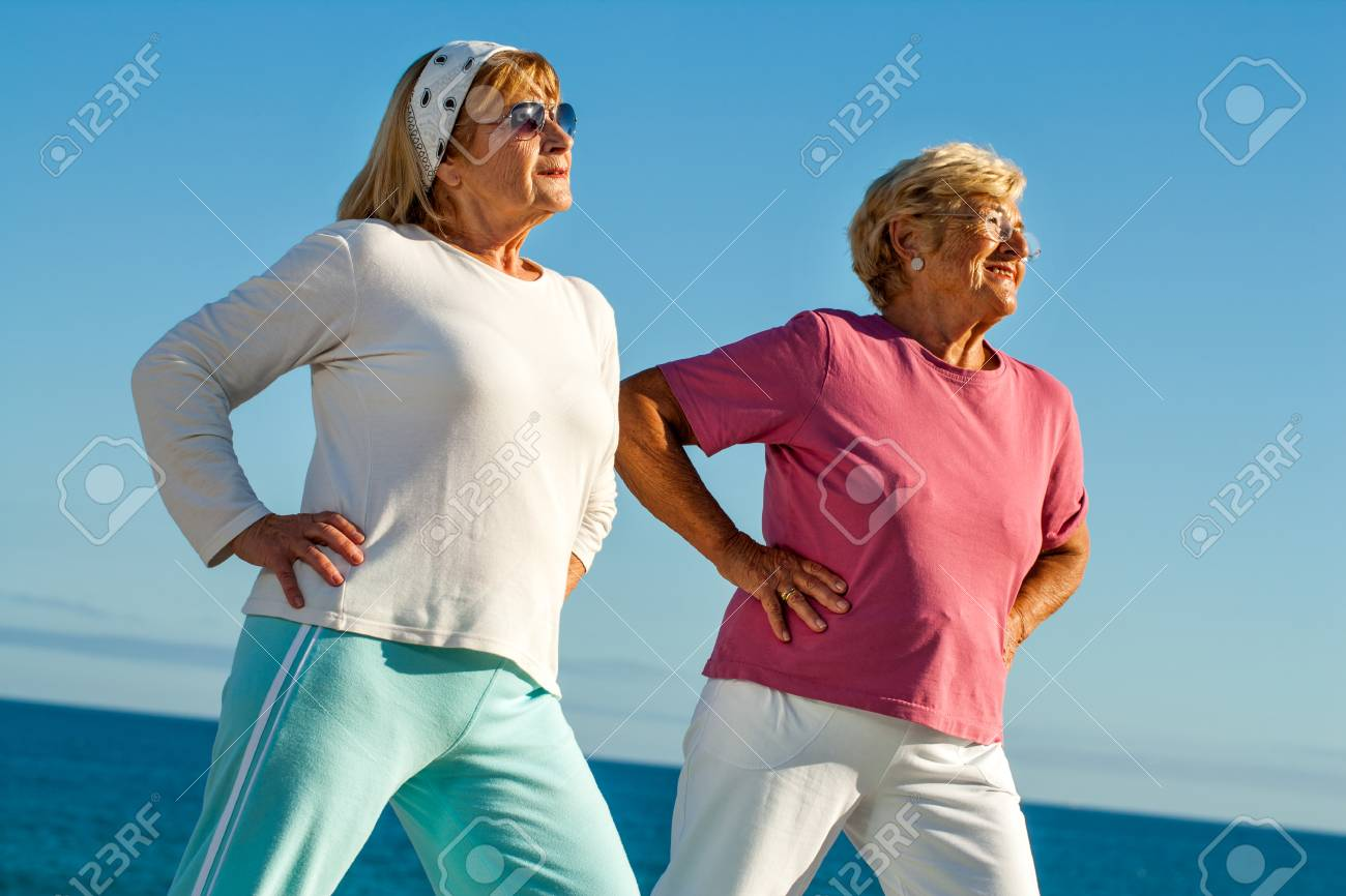Portrait of two elderly women stretching together outdoors. Stock Photo - 23712768
