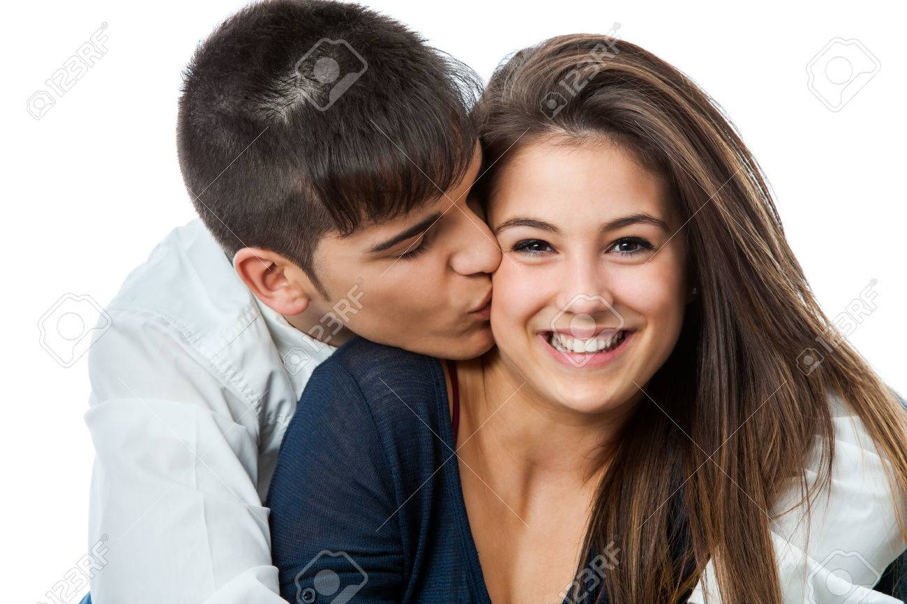 close up studio portrait of young boy kissing cute girlfriend
