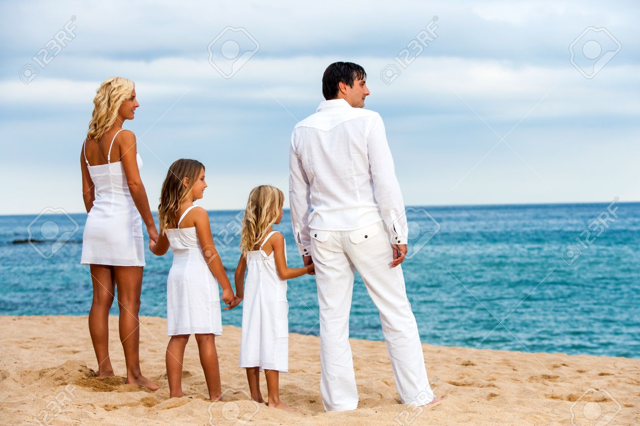 Cute Family in White on Beach