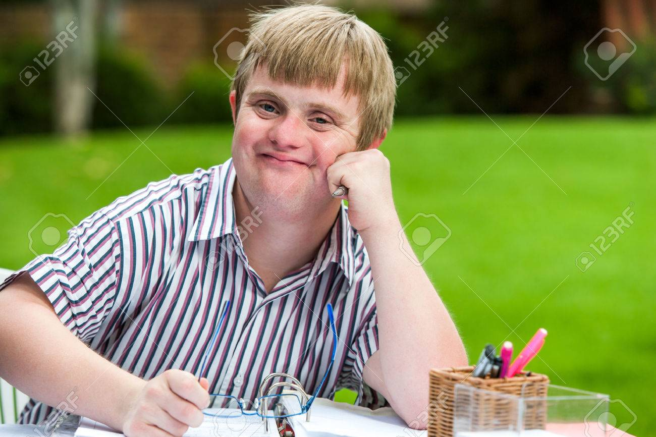 Coloring pages for down syndrome adults - Down Syndrome Adult Close Up Portrait Of Young Males Student With Down Syndrome At Desk