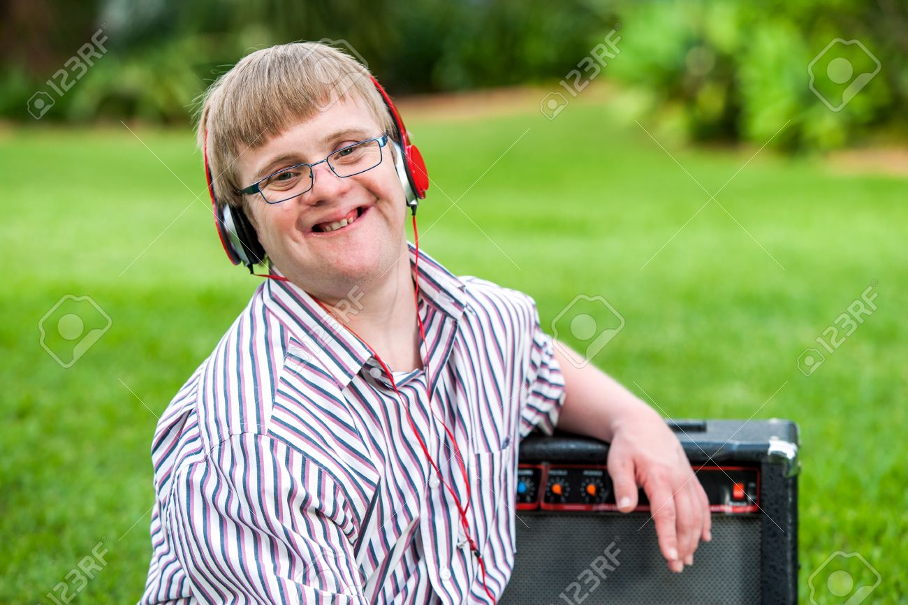 Coloring pages for down syndrome adults - Down Syndrome Adult Close Up Portrait Of Young Man With Down Syndrome Wearing Headphones Outdoors