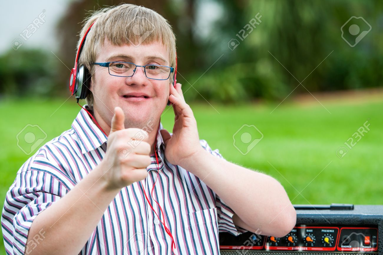 Coloring pages for down syndrome adults - Down Syndrome Adult Close Up Portrait Of Down Syndrome Boy With Headset Doing Thumbs Up