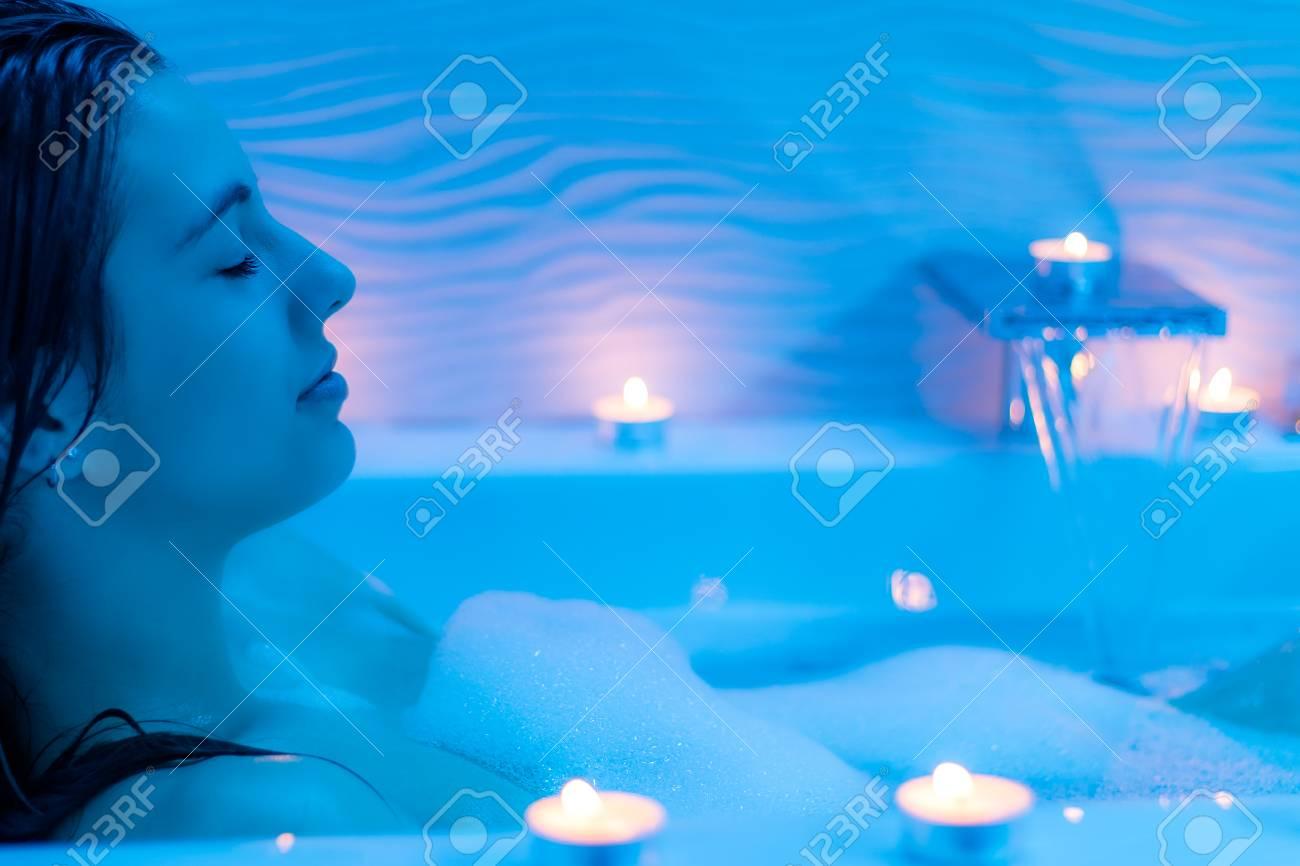 Close Up Low Light Ambient Portrait Of Woman Enjoying Foam Bath.Blue ...