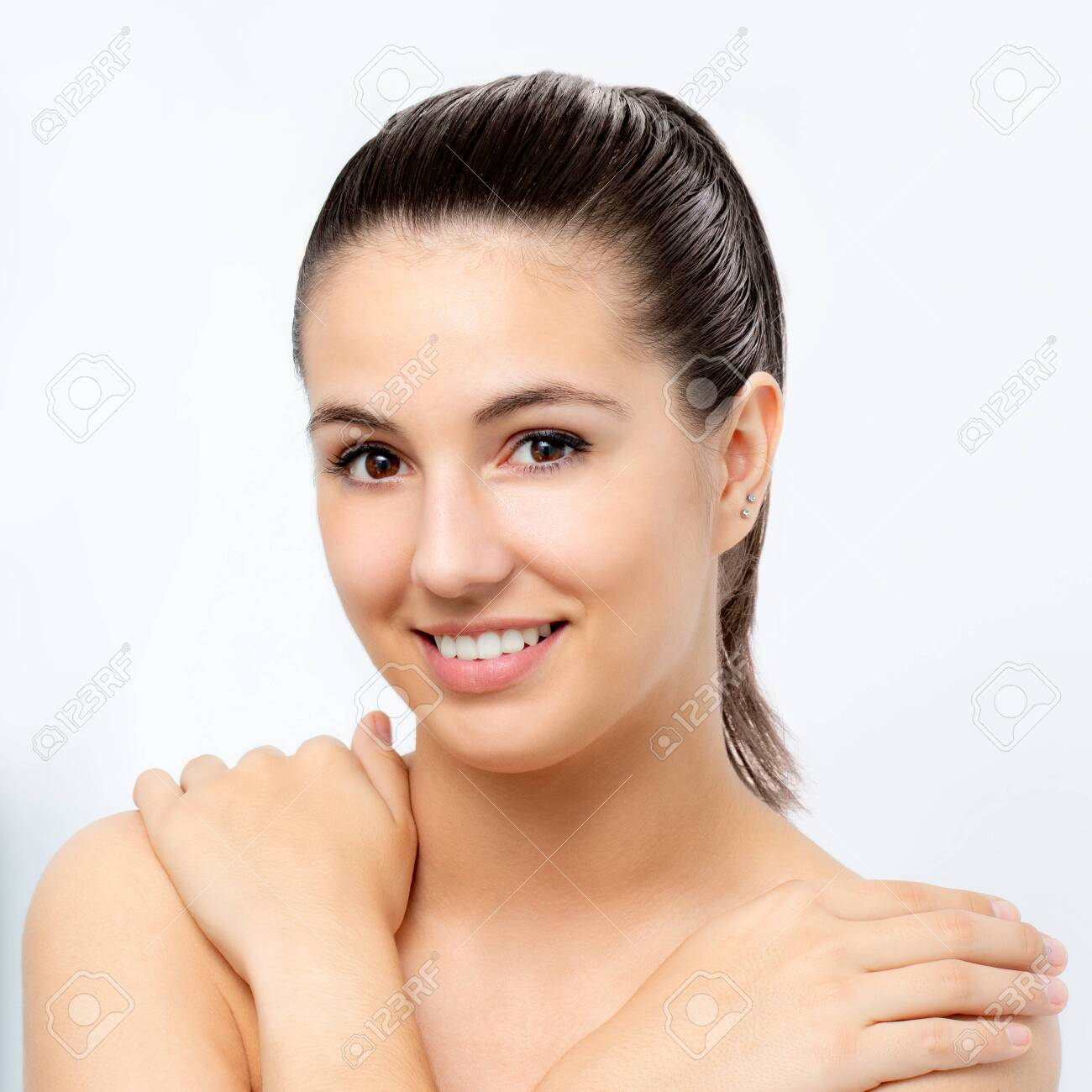 Close up beauty portrait of young attractive woman with hands on shoulders.Girl with healthy skin isolated on white background. - 131431000
