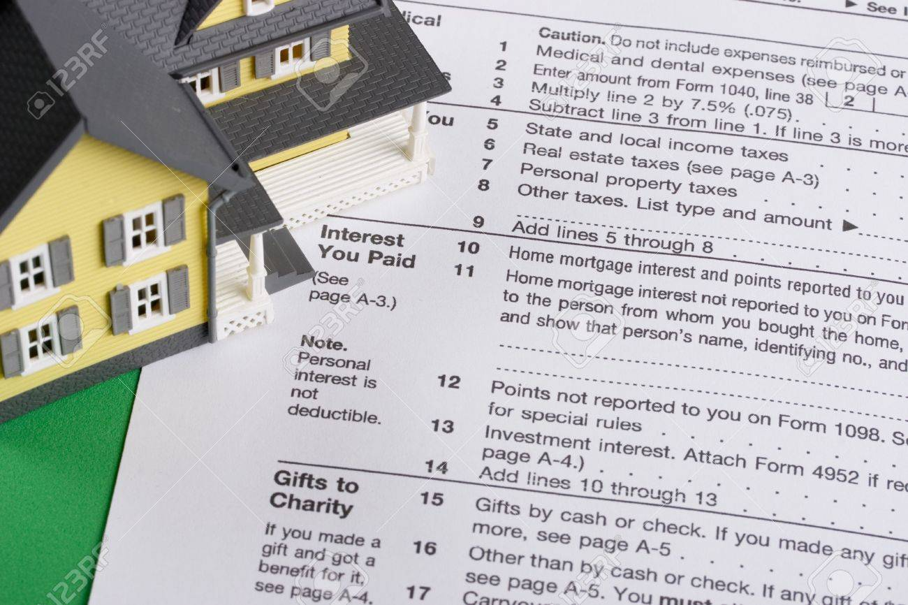 Federal Income Tax Form With Colorful Yellow House - Mortgage ...