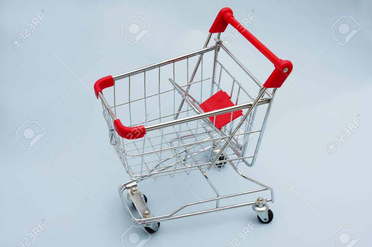 Shopping Cart with blue background with copy space Stock Photo - 2454093