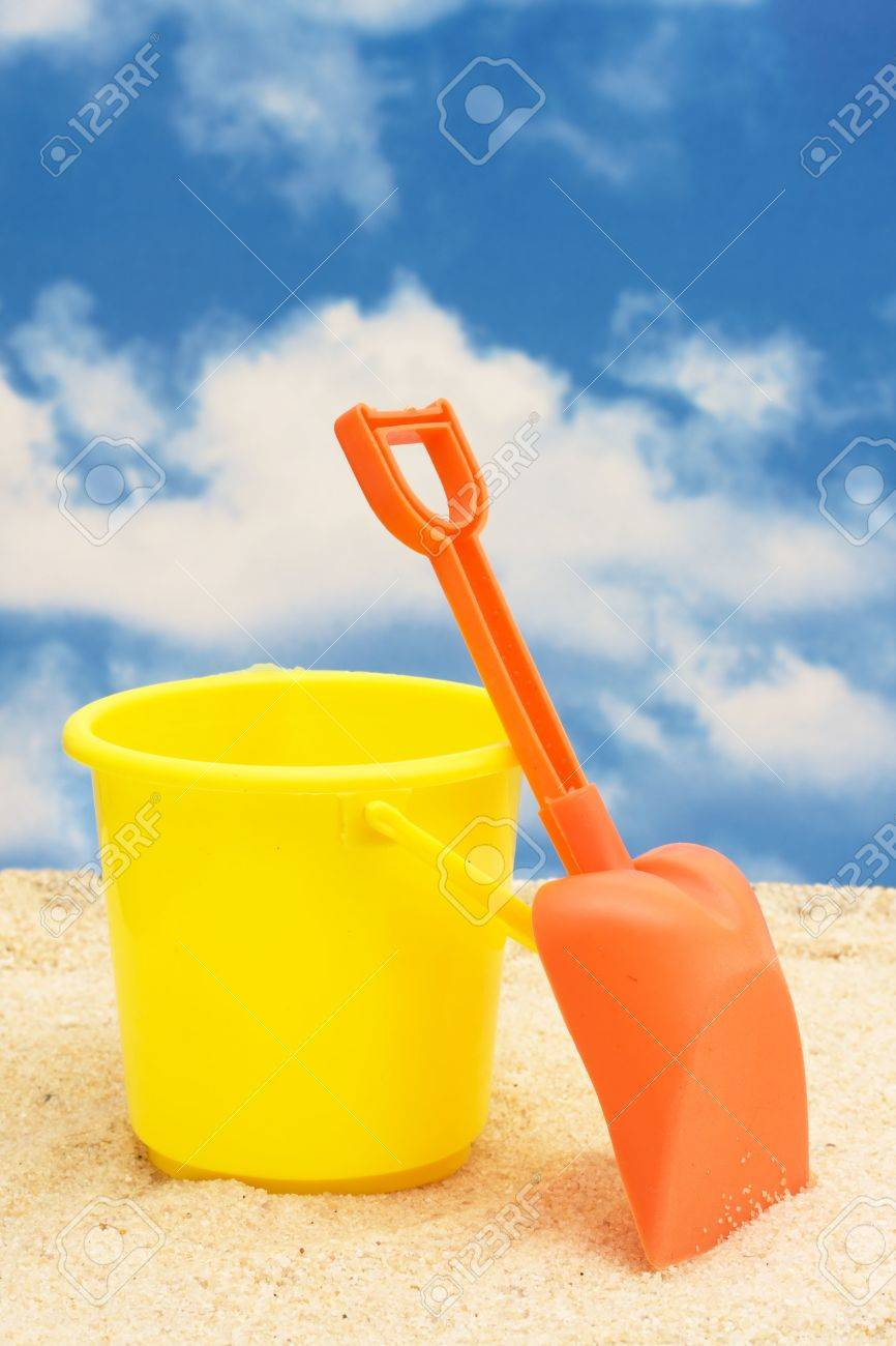 shovel and bucket in sand with copy space stock photo picture and