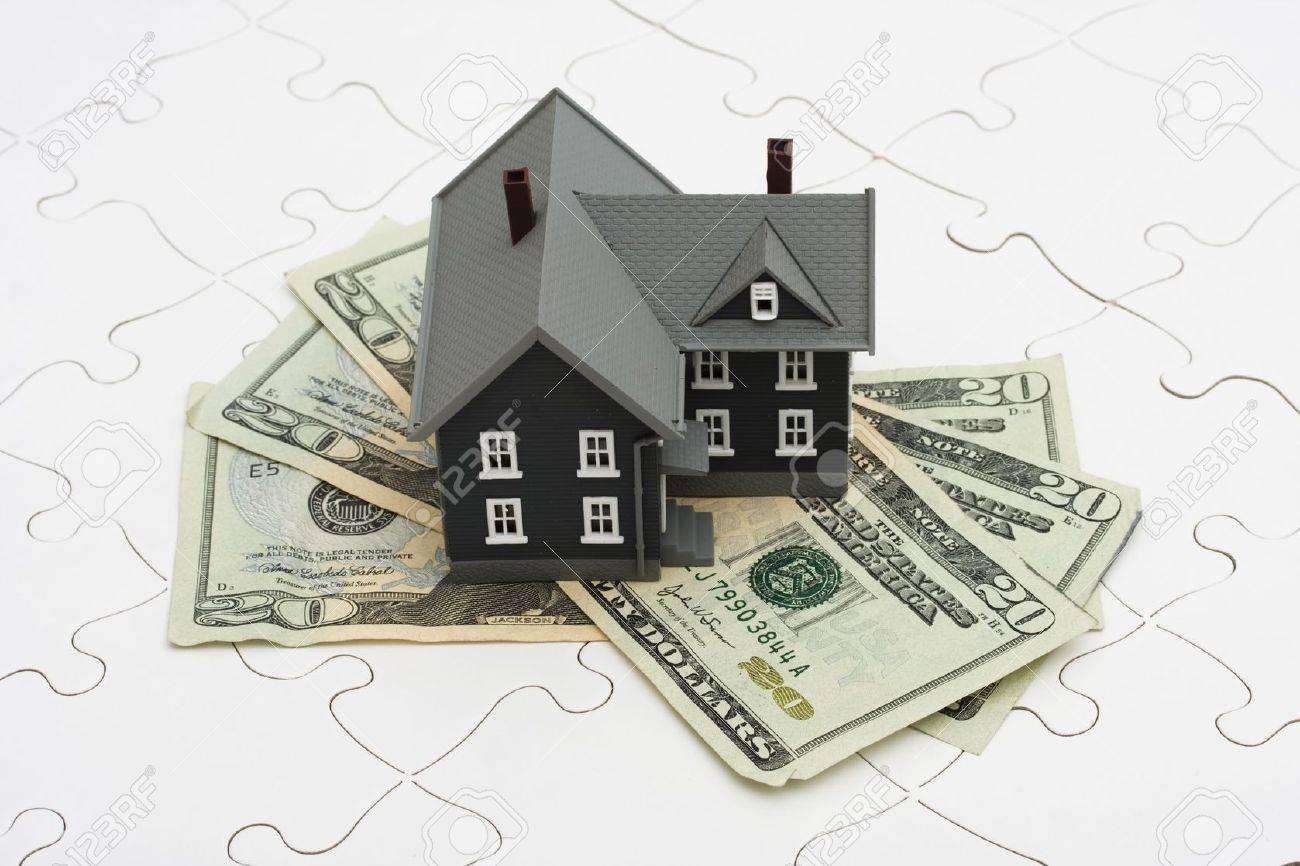 House sitting on a puzzle, the mysteries of the housing market Stock Photo - 3353455