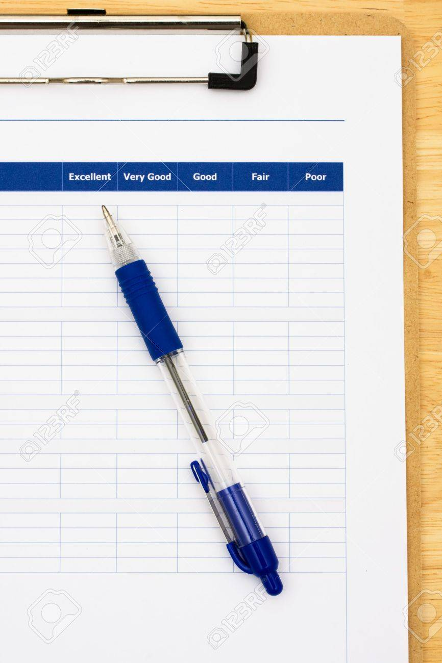 Survey attached to clipboard sitting on table with blue pen, excellent customer service Stock Photo - 3499615