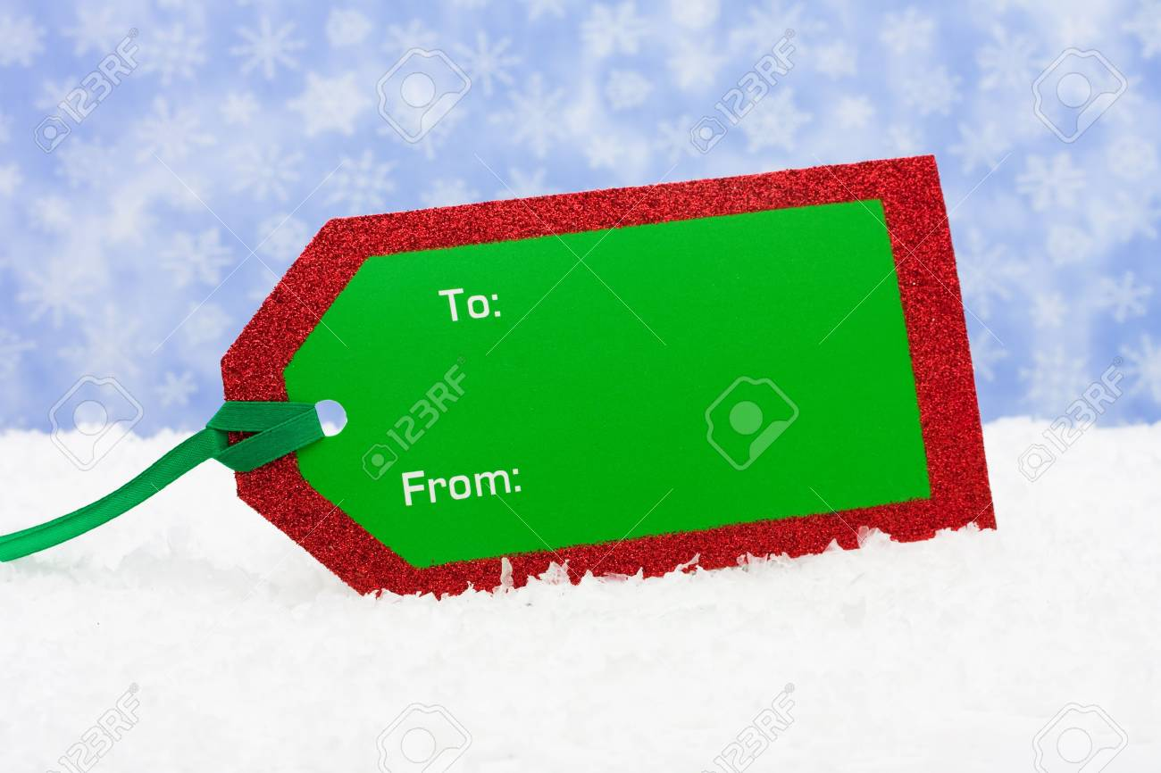 Blank gift tag sitting on snow with snowflake background, Christmas present Stock Photo - 3579836