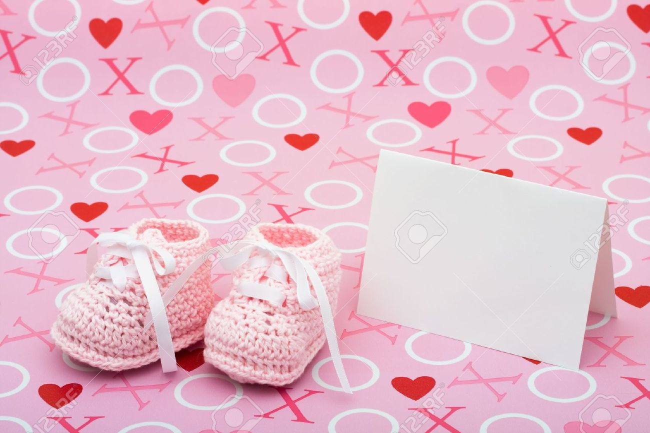 A White Card With Baby Booties On A Pink Love Background Baby Stock Photo Picture And Royalty Free Image Image 5457234