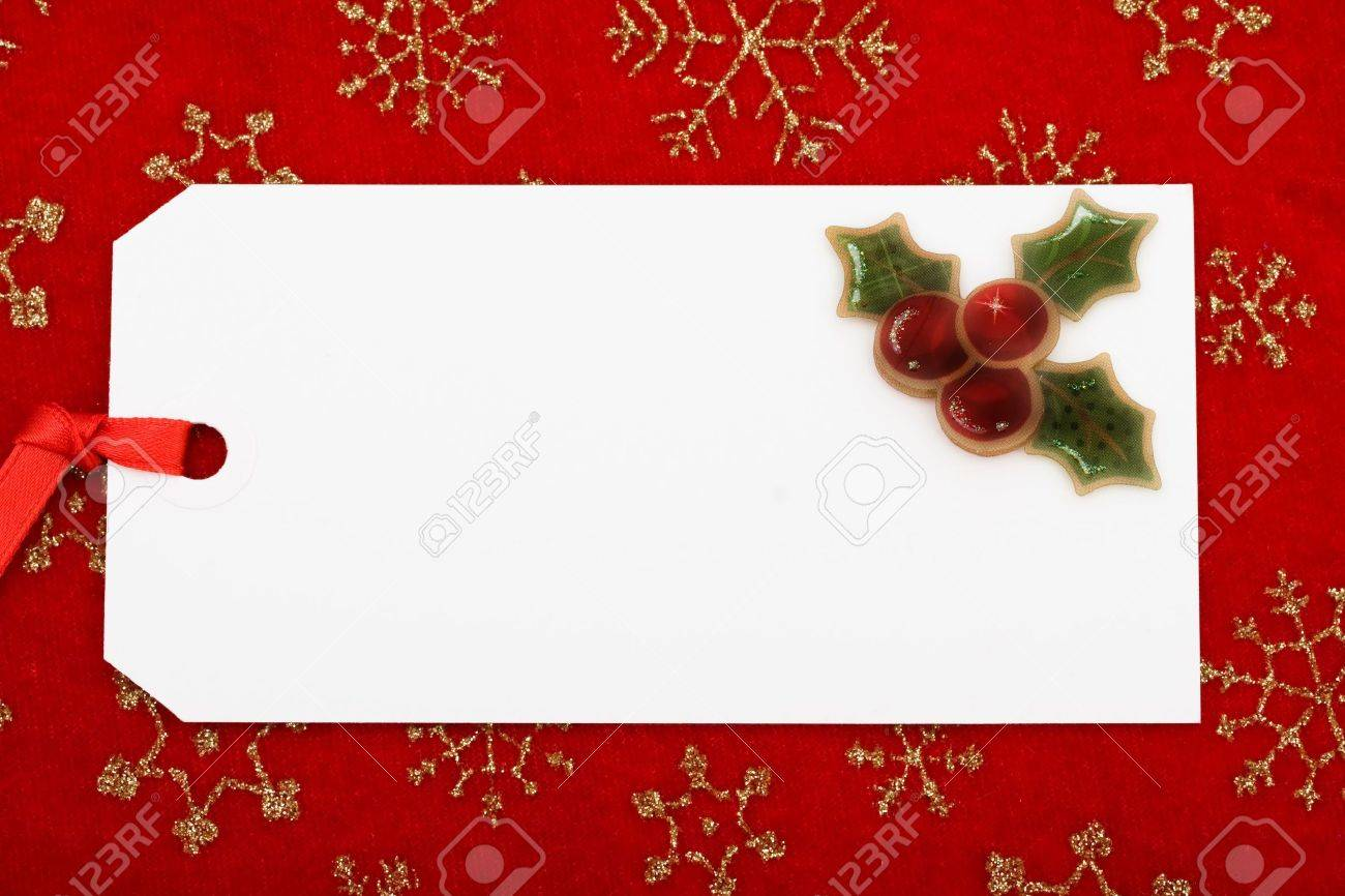 Christmas Gift Tag.A Blank Gift Tag On A Red Snowflake Background Christmas Gift