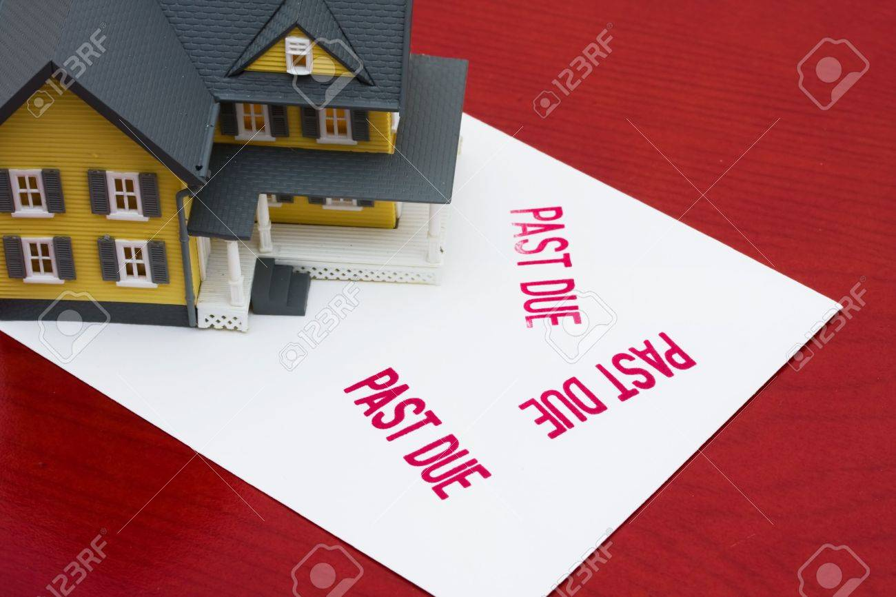 An overdue bill beside a house on red background, overdue mortgage Stock Photo - 5686280