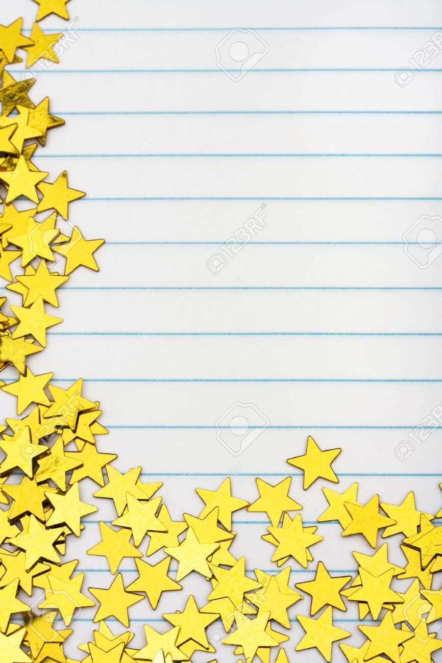gold stars making a border on a lined paper background, gold.. stock