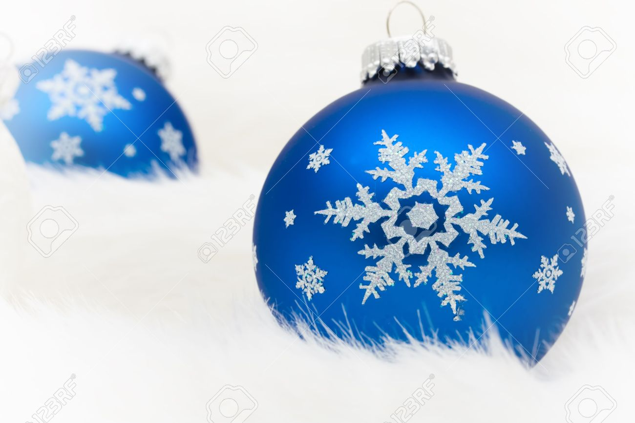 Blue Glass Christmas Ball Ornaments On A White Fur Background